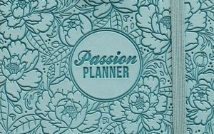 A photo of the cover of a blue Passion planner
